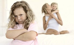 Girl Jealous of Mother and Sister --- Image by © Pixland/Corbis