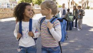 Classmates talking outdoors