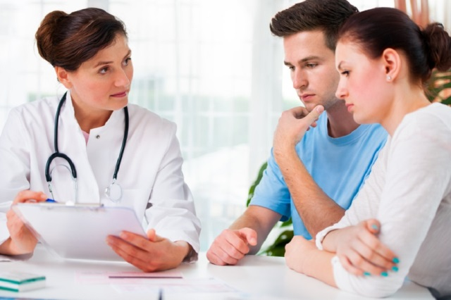 http://www.dreamstime.com/royalty-free-stock-images-doctor-consults-young-couple-image26142729