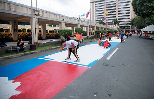 "High school students in the Philippines paint ""roads to safety for women and girls"""